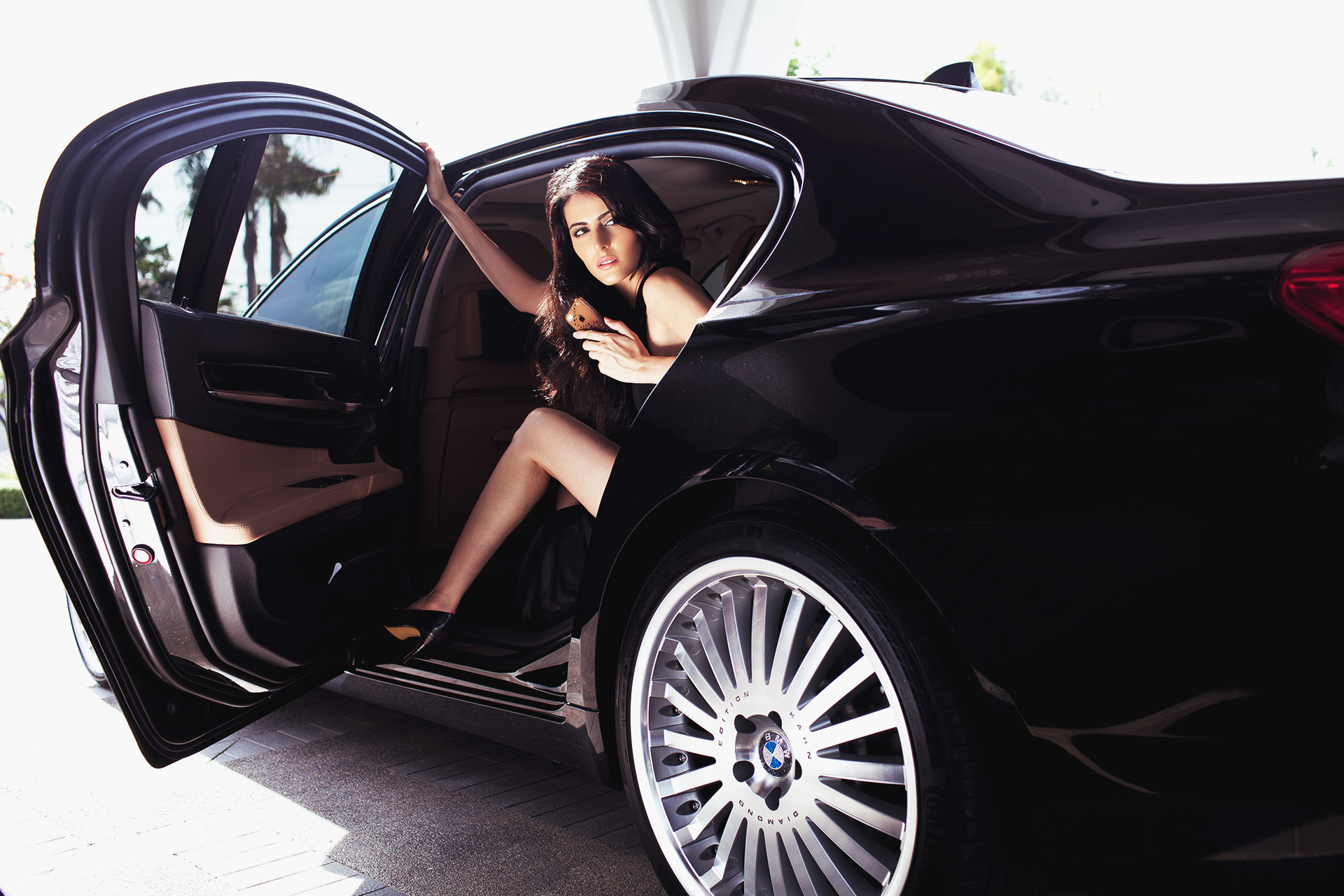 girl-exiting-luxury-bmw