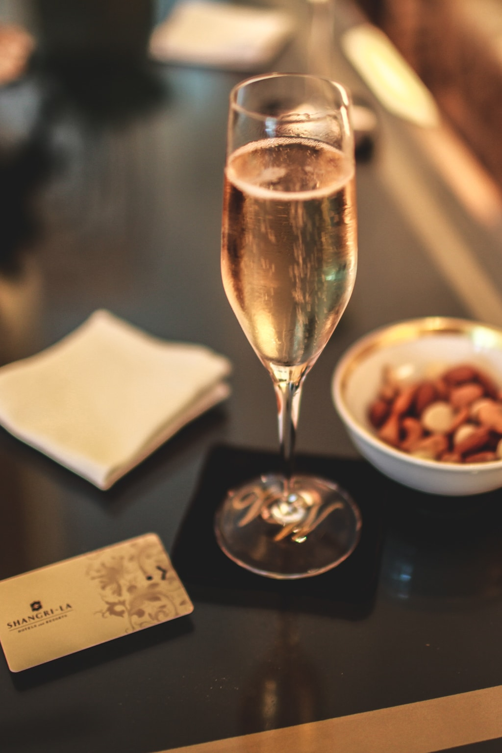 Glass of champagne and nuts