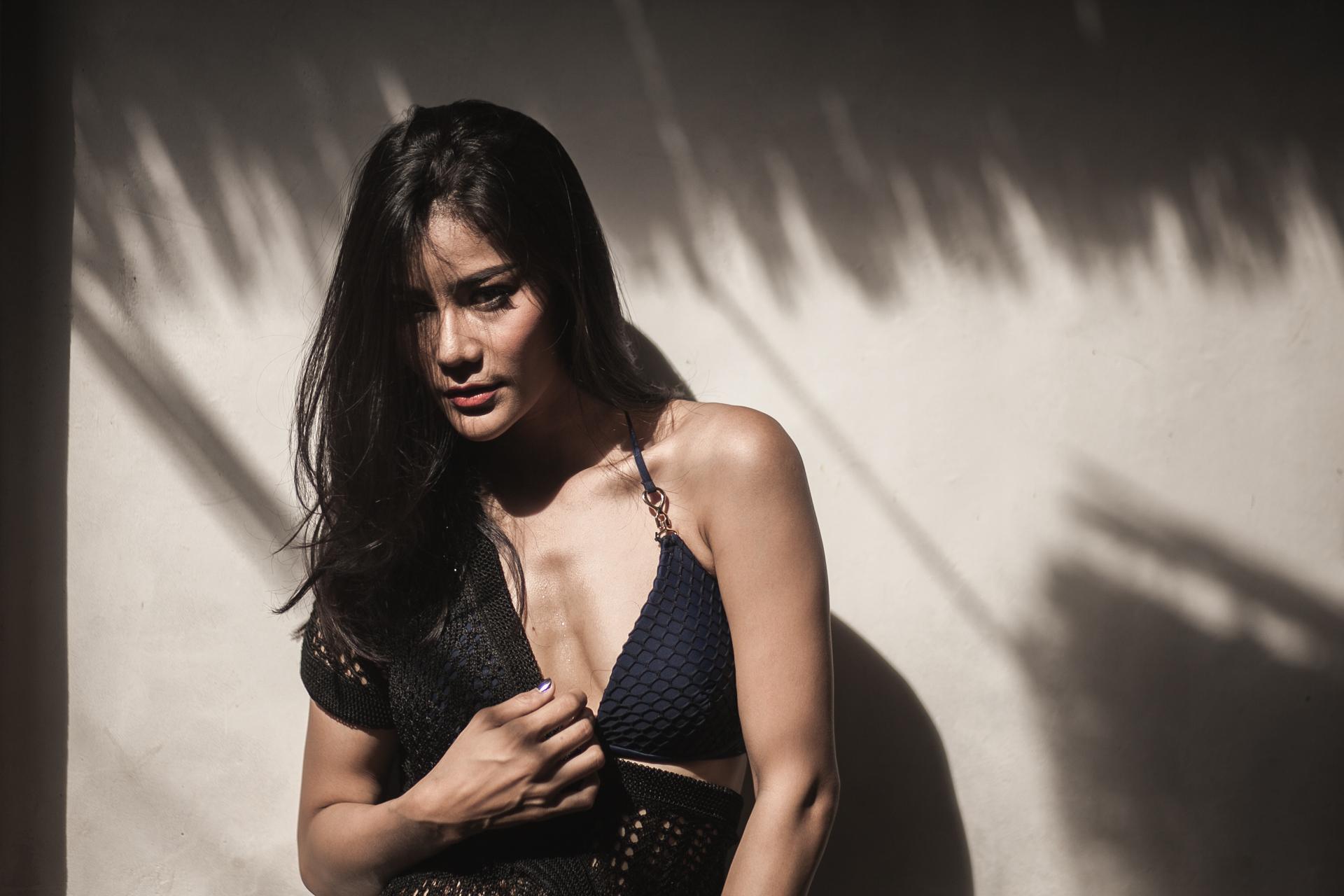 Sweaty model working the camera in her bikini